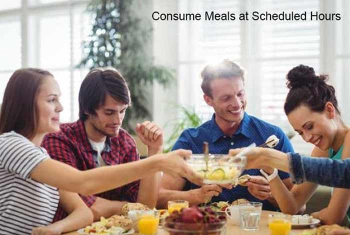consume meals at scheduled hours